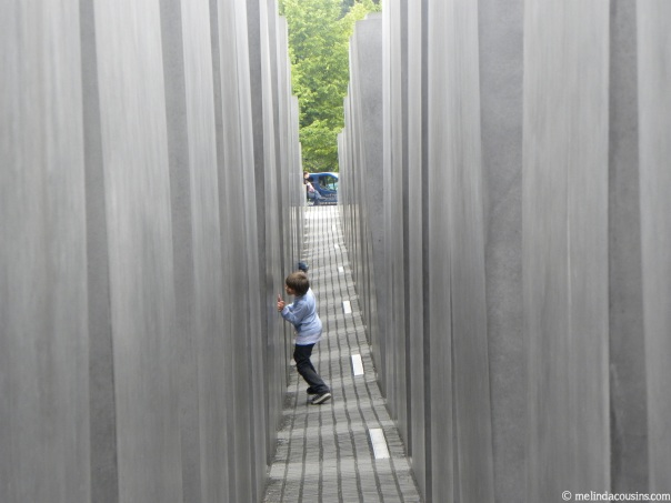 A young boy playing at the holocaust Memorial