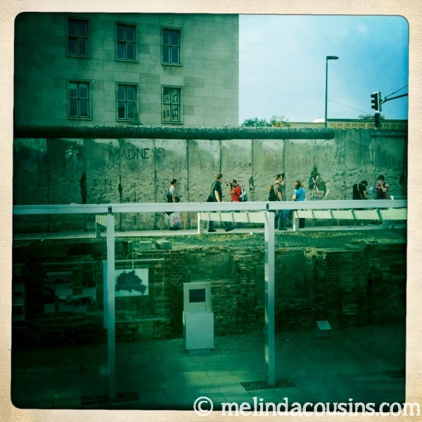 Some of the outdoor Topography of Terror's exhibits in front of a section of the Berlin Wall