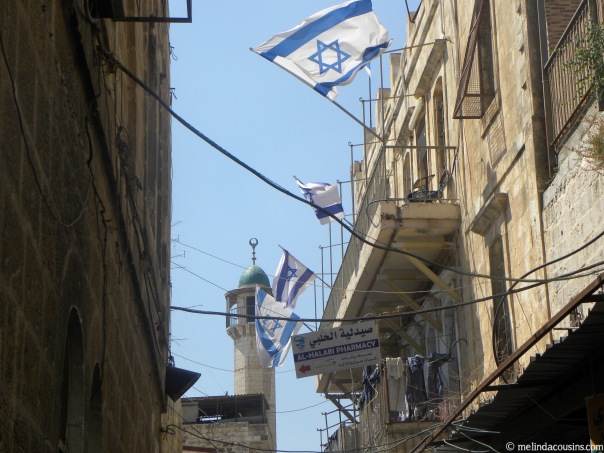 Mosque and Israeli flags