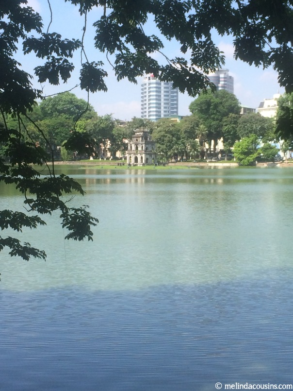 Lake with new and old buildings